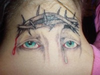 Eyes and crown of thornes tattoo on neck